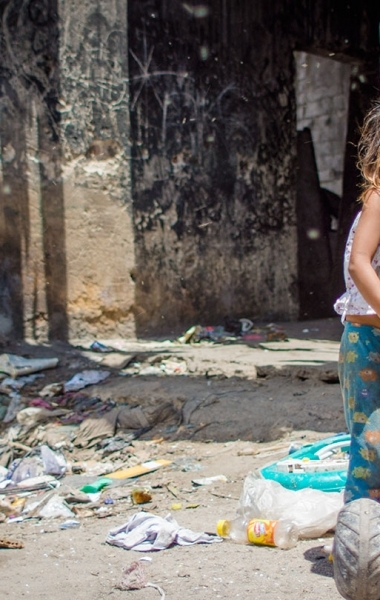 Girl playing at the Terminal Dump in Guatemala City