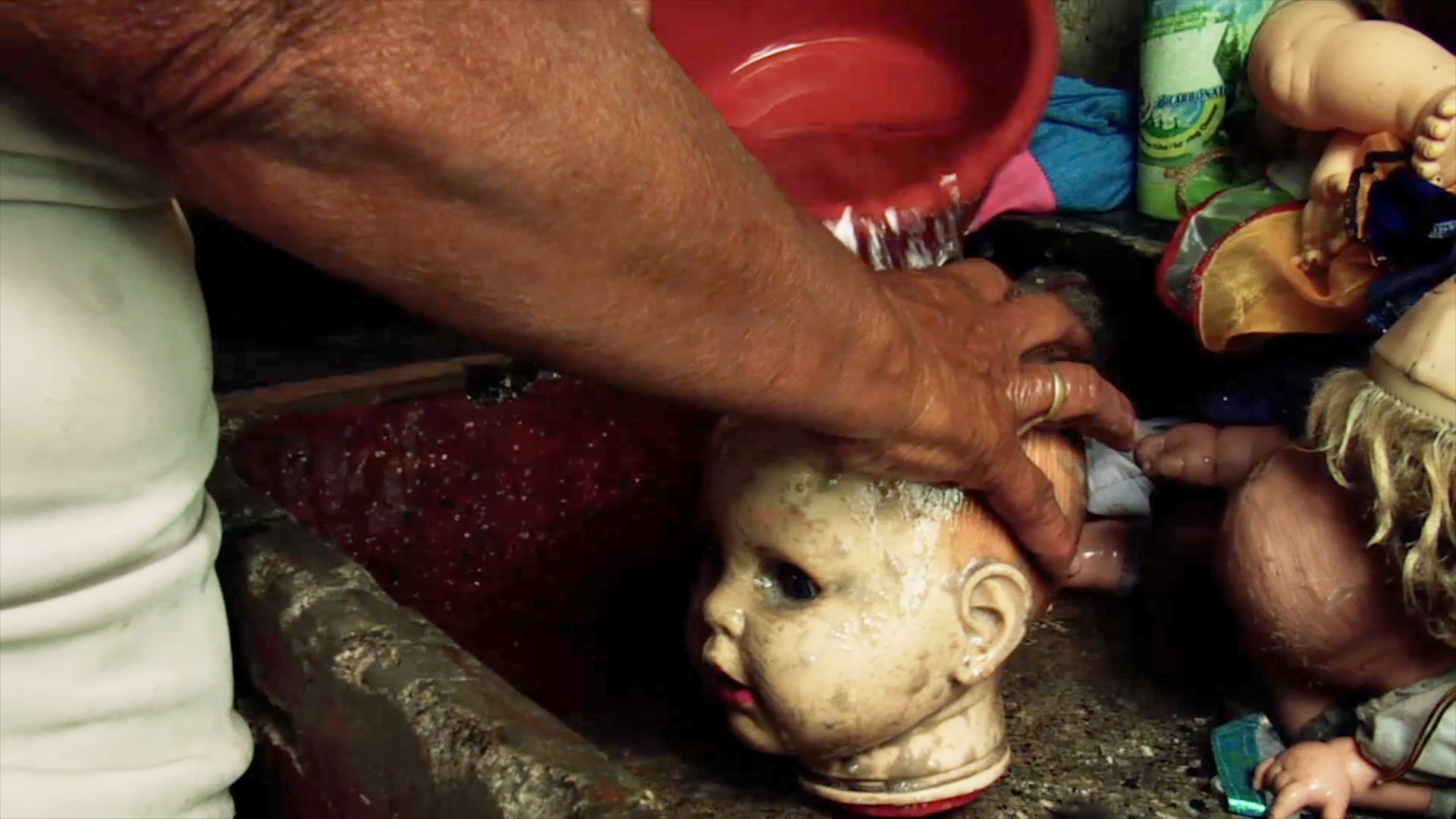 Washing the doll.