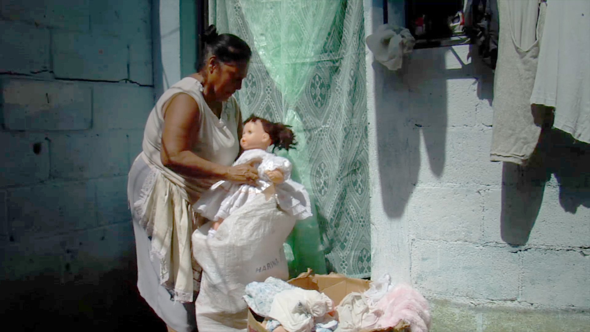 Taking the doll to the market.